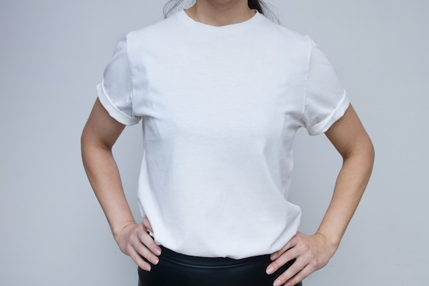 Woman in white t-shirt for mock up inscriptions