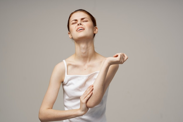 Woman in white t-shirt problems with trunks pain osteoporosis
