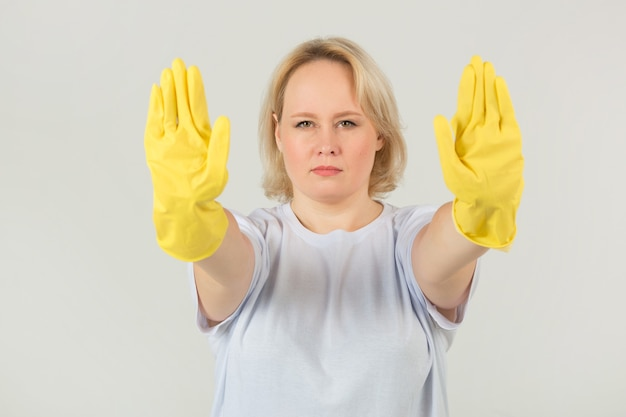 Woman in a white t-shirt in rubber gloves