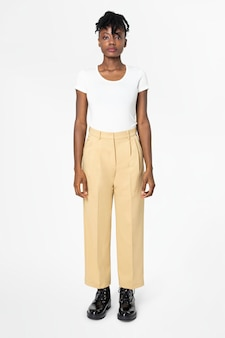 Woman in white tee and beige slacks casual wear fashion full body
