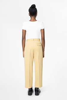 Woman in white tee and beige slacks casual wear fashion rear view