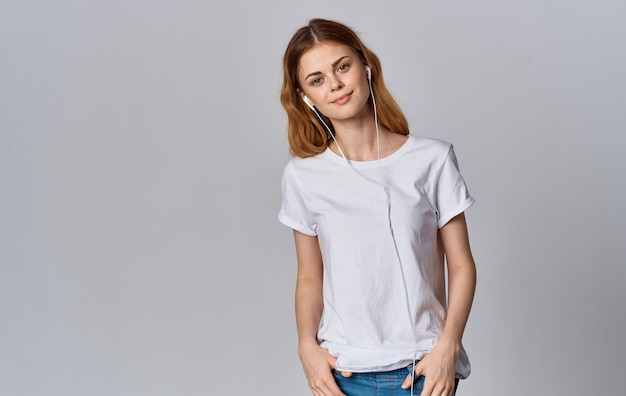 Woman in white tshirt music entertainment light background