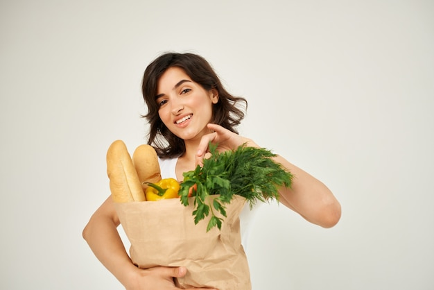 Woman in white tshirt package with groceries healthy food delivery supermarket