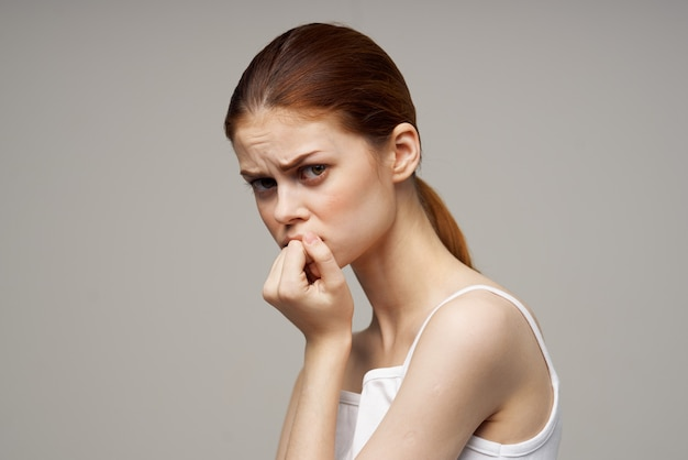 Woman in white tshirt toothache health problems disorder studio treatment