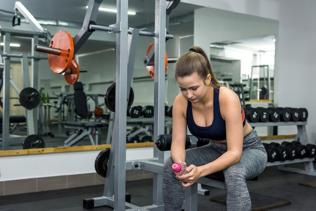 The woman will take break in the gym