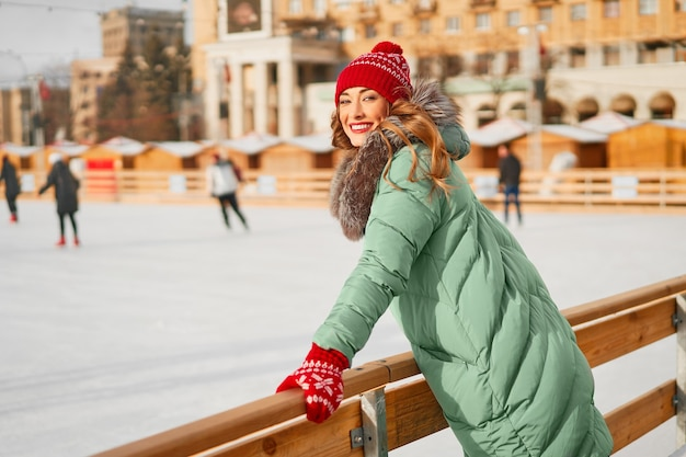 Woman winter outdoor ice rink background