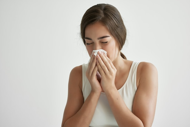 Woman wipes her nose with a handkerchief allergy runny nose health problems. high quality photo
