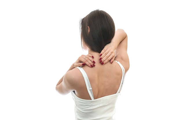 Woman with ache in neck isolated on white