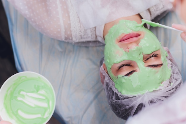 Woman with algae cream treatment for skin