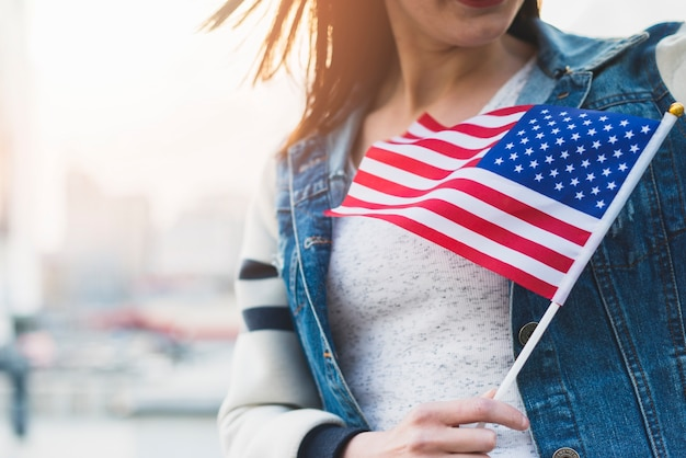 Woman with american flag on stick in hand