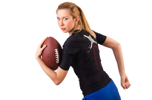 Woman with american football isolated on white