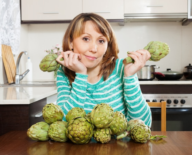 Woman with artichokes