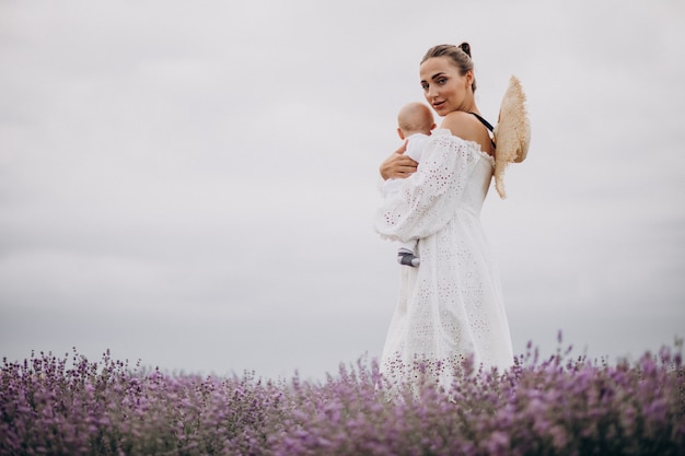 Woman with baby son in a lavander field
