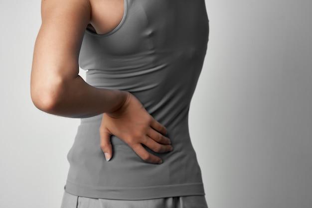 Woman with back pain traumatology isolated background medicine