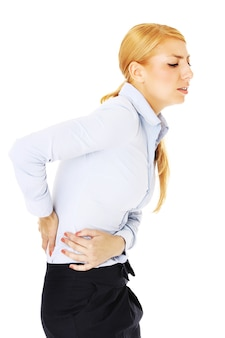 A woman with back problems over white background