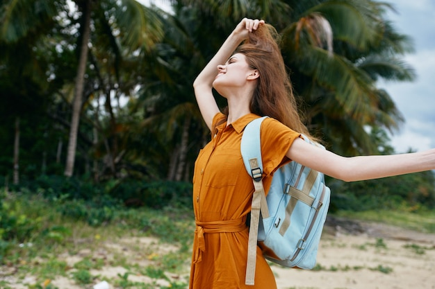 Woman with backpack on the island travel tourism