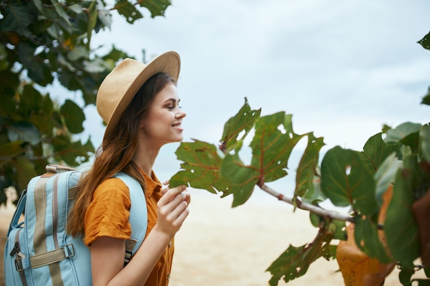Woman with backpack on nature travel island exotic