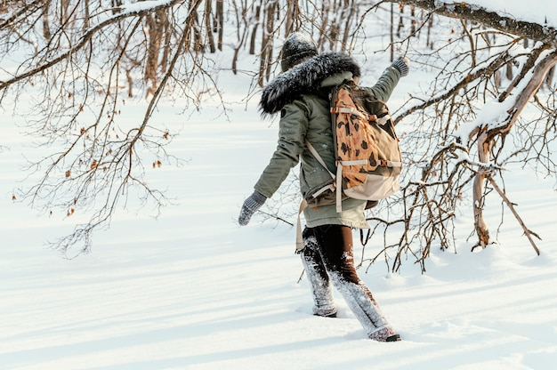 Woman with backpack on winter day
