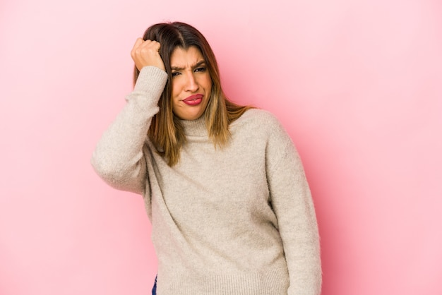 Woman with a bad reaction isolated on pink