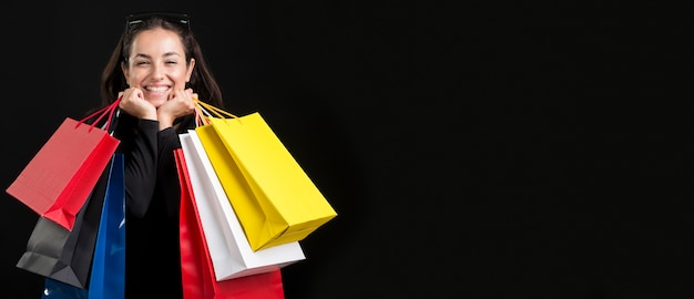 Woman with bags copy space black friday shopping event