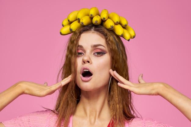 Woman with bananas wavy hair fruits lifestyle bright makeup pink.