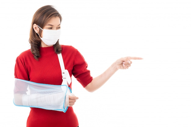 Woman with bandage in arm and mask