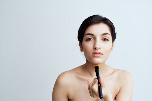 Woman with bare shoulders makeup skin care close-up