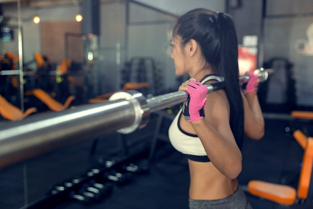 Woman with battle rope in functional training fitness gym of woman taking weight loss