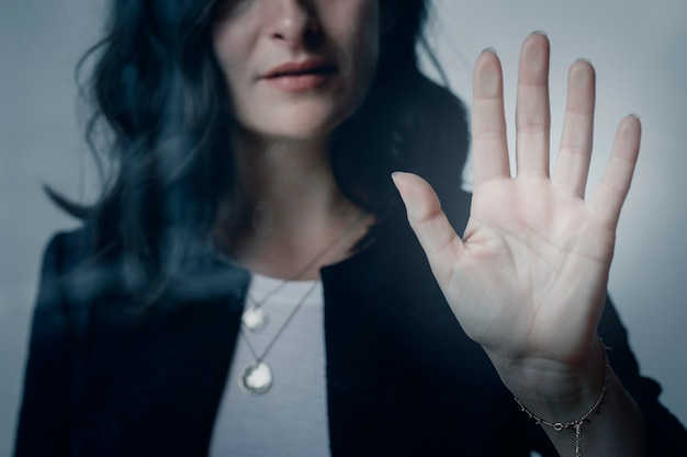 Woman with a beautiful hand touching the window