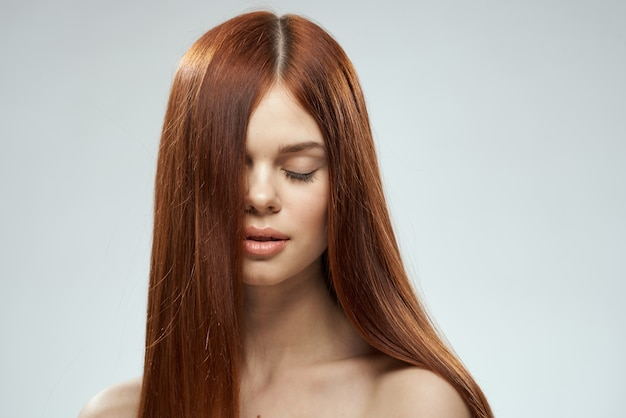 Woman with beautiful long hair care nude shoulders cosmetics
