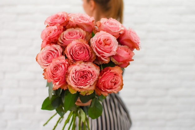 Woman with beautiful peonies. flower bouquet in female hands.