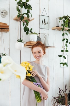 Woman with beautiful yellow bouquet