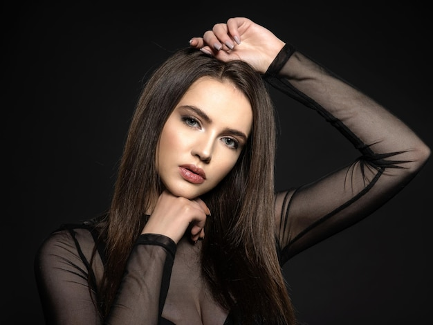 Woman with beauty long brown hair. fashion model with long straight hair. fashion model posing . pretty woman with long straight brown hair
