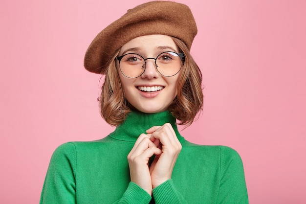Woman with beret and turtleneck sweater