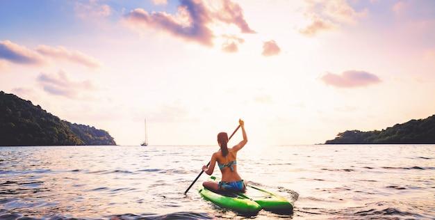 Woman with bikini on paddle board