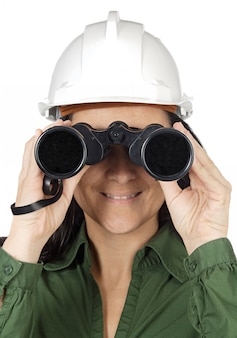Woman with binoculars and helmet over white background