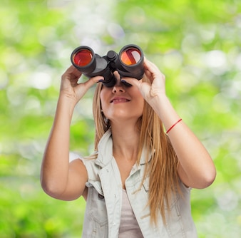 Woman with binoculars in the field
