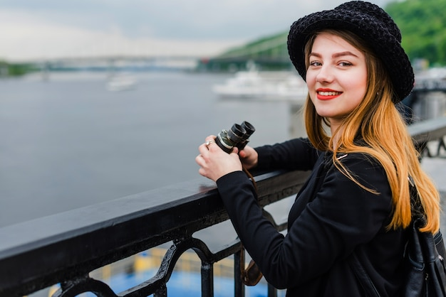 Woman with binoculars at waterfront