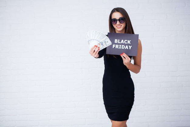 Woman with black friday inscription and money