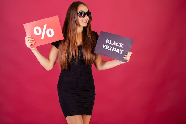 Woman with black friday and percentage inscription