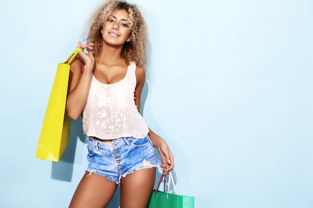 Woman with blond afro hairstyle after shopping