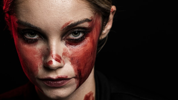 Woman with bloody makeup and copy space