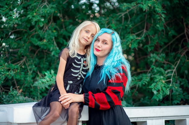 Woman with blue hair hugging with her daughter