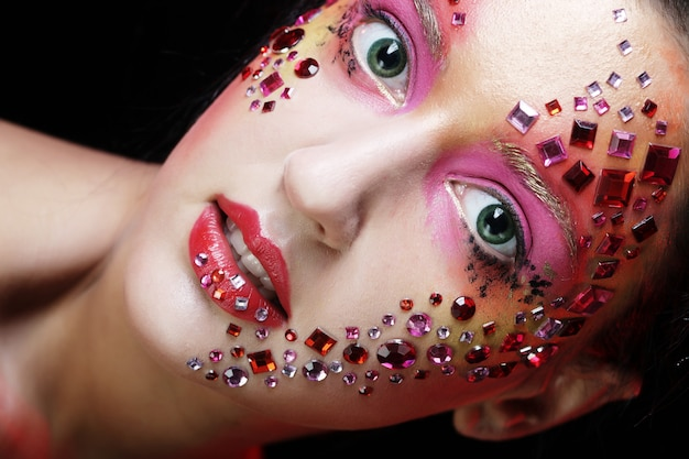 Woman with bright artistic make up