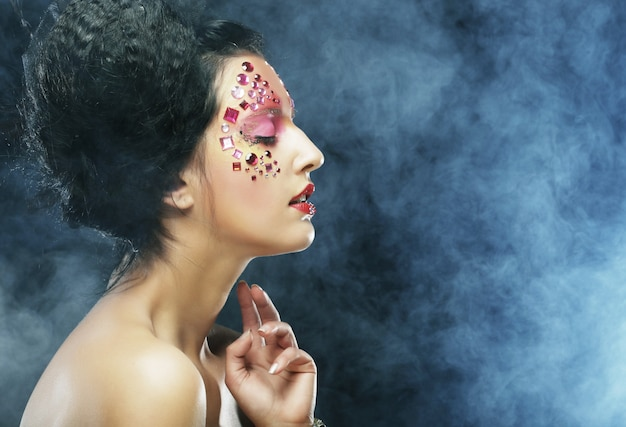 Woman with bright artistic make-up