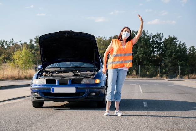 Woman with broken down car trying to get help