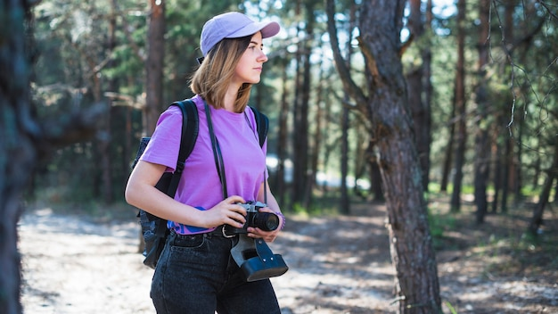 Woman with camera and cap