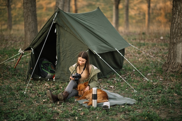Woman with camera near tent