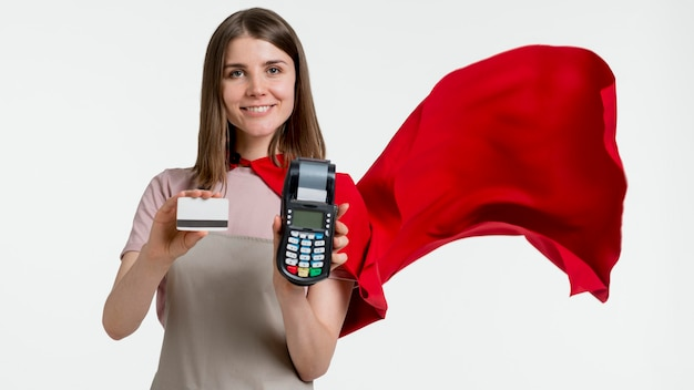 Woman with cape holding pos and card