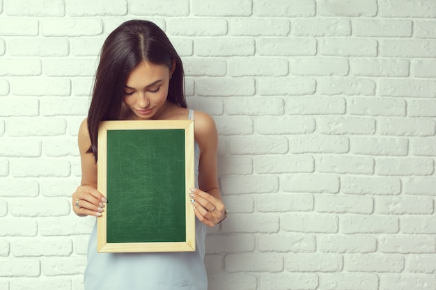 Woman with chalk board